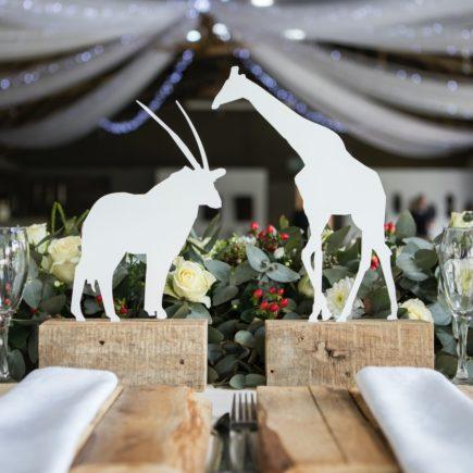 Two White Napkins Across White Silhouette of Animals