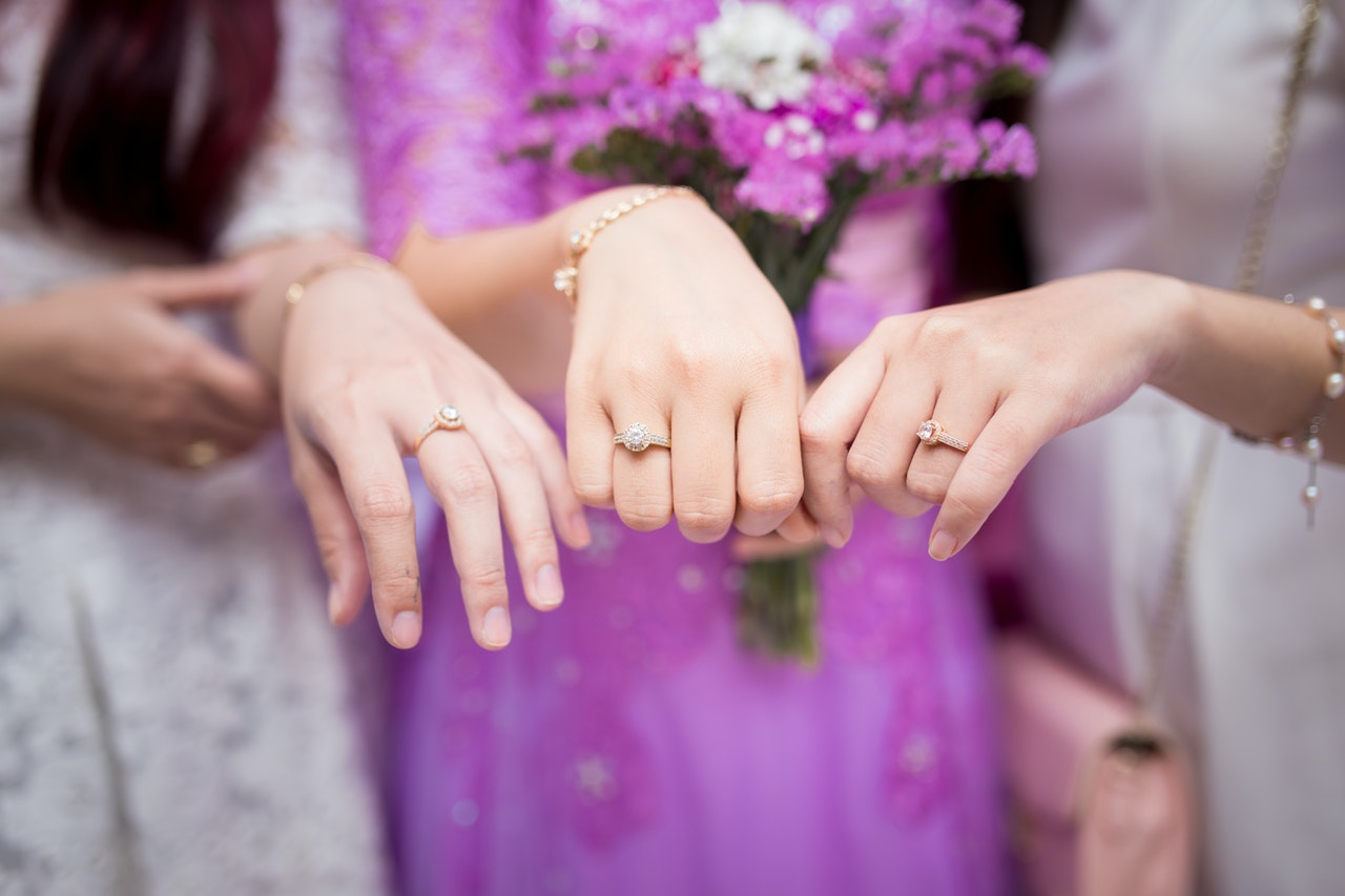 Three Women Showing Solitaire Rings