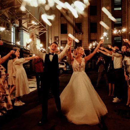 Happy Friends and Newlywed Couple Celebrating Wedding at Night